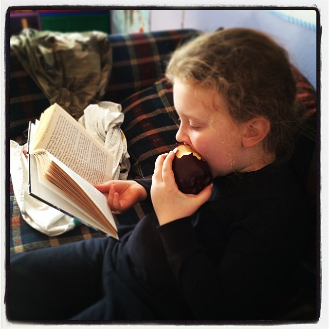 Reading AND eating an apple?? Will wonders never cease?? #homeschool #reading