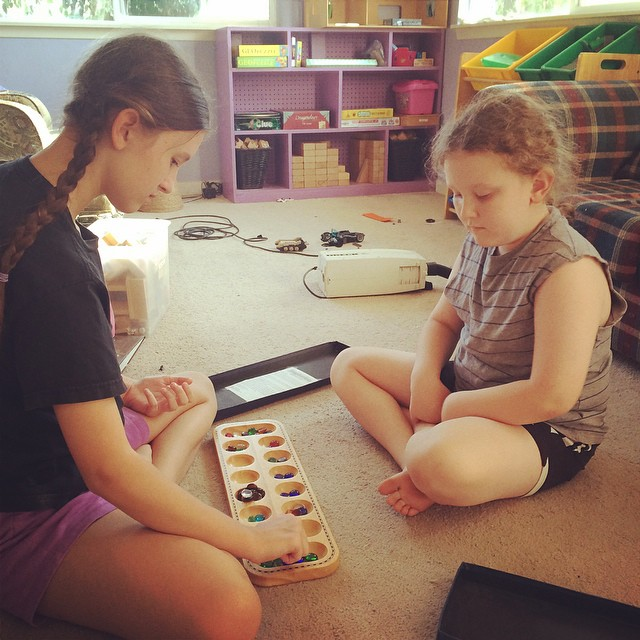 Playing mancala. --Tina