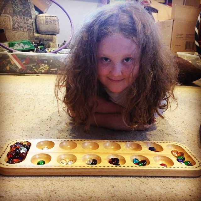 My wild boy child mancala partner. #homeschool #games